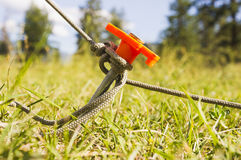 Tent peg and rope. Rope attached to tent peg stock photography