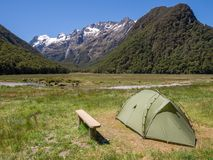 A tent pitched at Routeburn Flats Hut Campsite on Routeburn Track, New Zealand royalty free stock photography