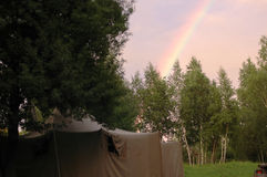 Tent and rainbow stock image
