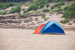 Tent on a river beach. Couple tent on a river beach Stock Photography