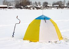 Tent on the river ice Stock Photo
