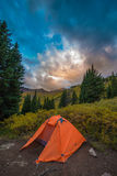Tent in the Rockies. Bright Orange Tent Conundrum Hot Springs Colorado Rockies Royalty Free Stock Photography