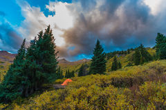 Tent in the Rockies. Bright Orange Tent Conundrum Hot Springs Colorado Rockies Royalty Free Stock Photo