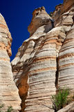 Tent Rocks. Partial view of red and beige layered hoodoo rock formations from bottom of canyon at Tent Rocks in New Mexico Royalty Free Stock Photography