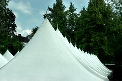 Tent roofs. A row of tent roofs at an event Royalty Free Stock Photo