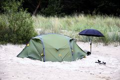 Tent on sandy beach Stock Photos