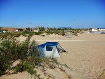 Tent on the sandy beach stock photos