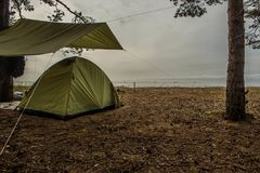 Tent on the sandy shore of the Gulf Stock Images