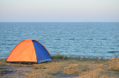 Tent on the sea shore Stock Photography