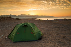 Tent sea and sunrise Stock Image