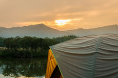 Tent set on the grassland of mountain Stock Images