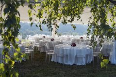 Tent with set tables for outdoor banquet Royalty Free Stock Image