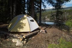 Tent set up on campsite. A tent set up on a campsite in forest by the lake royalty free stock images