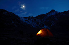 Tent Shining At Night In The Mountains Royalty Free Stock Image