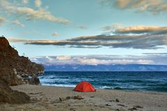 Tent on the shore of the lake. royalty free stock photos
