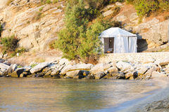 Tent on the shore of the sea Stock Images