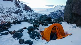 Tent in the snow near Fitz Roy mountain in the Patagonia region near El Chalten, Argentina. stock photo