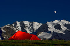 Tent in the solitude beneath the glaciers of the Alps. Tent in solitude under the glaciers in the Swiss Alps Royalty Free Stock Photo