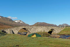 Tent by Spey river at Garva bridge, Scotland in spring Stock Images