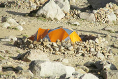 A tent standing in the wild mountains Stock Image
