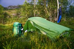 The tent stands in a clearing in the field with trees royalty free stock photography