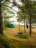 The tent stands on the shore of forest laken royalty free stock photos