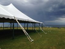 Tent and storm stock photos