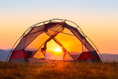 Tent glowing in beautiful sunset light. Tent in the sunset light Stock Photography