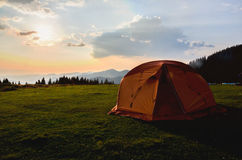 Tent on sunset mountains. Tent in the sunset overlooking mountains and a valley Stock Image