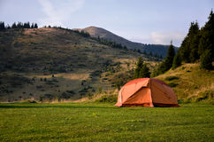 Tent on sunset mountains. Tent in the sunset overlooking mountains and a valley Royalty Free Stock Photography