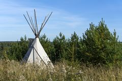 Tent tipi in the autumn landscape royalty free stock photography