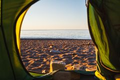 We look from the tent to the sea stock images