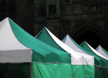 Tent tops in medieval setting Royalty Free Stock Image