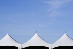 Tent Tops and Sky. A set of three symmetrical tent tops with open sky above Royalty Free Stock Image