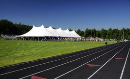 Tent and Track. A large white tent set up in the field Royalty Free Stock Photos