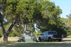 Tent and truck on a campsite Royalty Free Stock Photos
