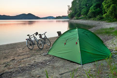 Tent and two bicycles Stock Images