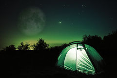 Tent under stars and moon Royalty Free Stock Photo