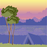 Tent under a tree on the nature at sunset by a lake. The picture Royalty Free Stock Photo