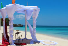 Tent for a wedding ceremony on the tropical beach. Stock Photo