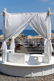 Tent with white fabric on the sea. stock photos