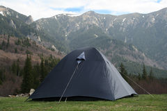 Tent in the wilderness. Tent pitched in the wilderness with mountains in the background Royalty Free Stock Photography