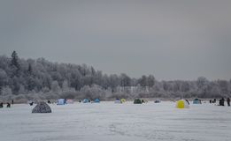 Tent for winter fishing on the ice stock photos