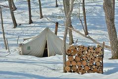 Tent in winter forest 2. The broken tent in winter forest Stock Images