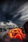 Tent among winter mountains. Stock Photo