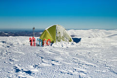 Tent winter mountains.Tent stands in the mountains in the snow. Snowshoes are beside the tent. Stock Photography