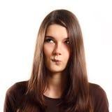 Tentativa adolescente da menina a escolher Fotos de Stock Royalty Free
