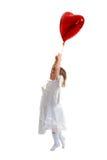 Tentativa da menina a voar Imagem de Stock