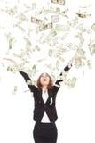 Tentativa da mulher de negócios para travar o dinheiro Fotografia de Stock Royalty Free