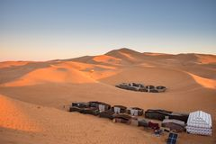Tented camp, Merzouga, Morocco. View of tented camp at sunrise, Merzouga, Morocco Royalty Free Stock Image